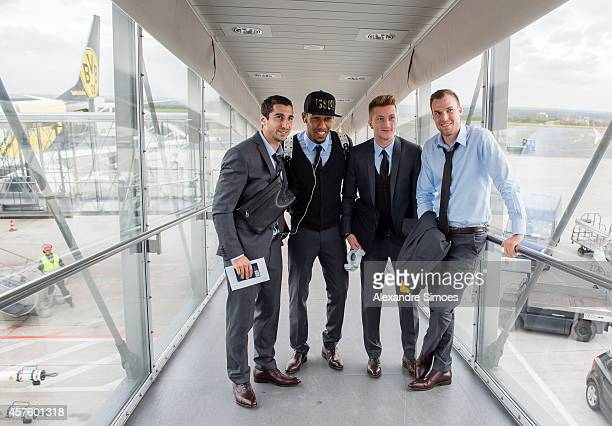 Henrikh Mkhitaryan PierreEmerick Aubameyang Marco Reus and Kevin Grosskreutz of Borussia Dortmund at the Dortmund airport prior to their UEFA...
