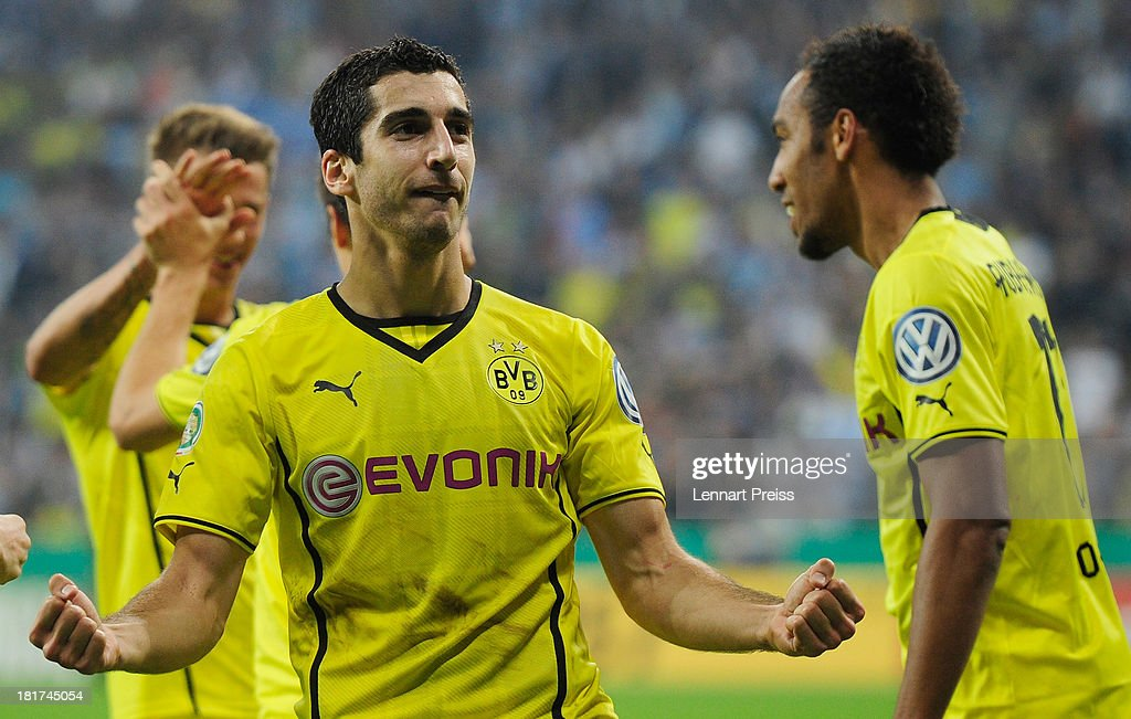 Henrikh Mkhitraryan (L) of Dortmund celebrates the team's second goal during the DFB Cup match between TSV 1860 Muenchen and Borussia Dortmund at Allianz Arena on September 24, 2013 in Munich, Germany.