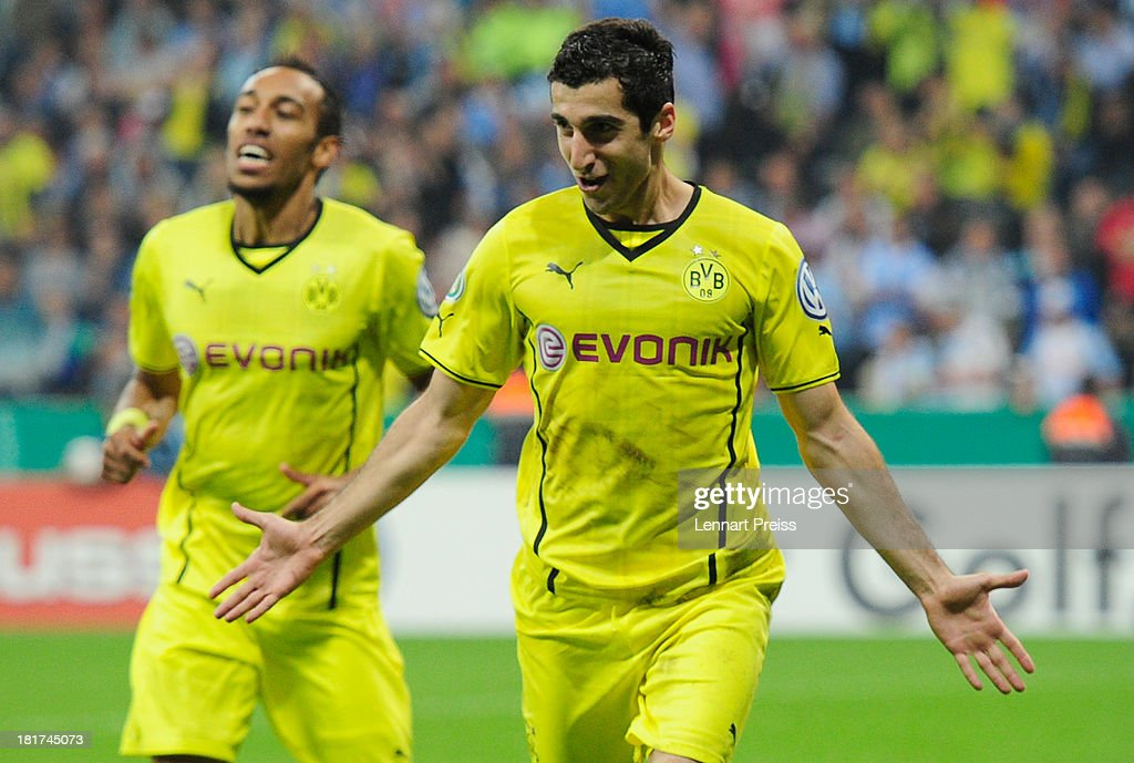 Henrikh Mkhitraryan (R) of Dortmund celebrates with <a gi-track='captionPersonalityLinkClicked' href=/galleries/search?phrase=Pierre-Emerick+Aubameyang&family=editorial&specificpeople=6344916 ng-click='$event.stopPropagation()'>Pierre-Emerick Aubameyang</a> after scoring their team's second goal during the DFB Cup match between TSV 1860 Muenchen and Borussia Dortmund at Allianz Arena on September 24, 2013 in Munich, Germany.