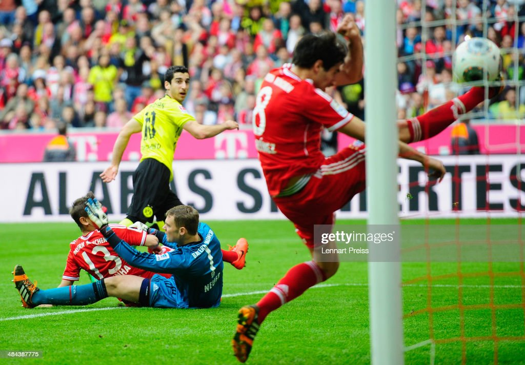 Henrikh Mkhitraryan (back) of Dortmund scores the opening goal during the Bundesliga match between FC Bayern Muenchen and Borussia Dortmund at Allianz Arena on April 12, 2014 in Munich, Germany.