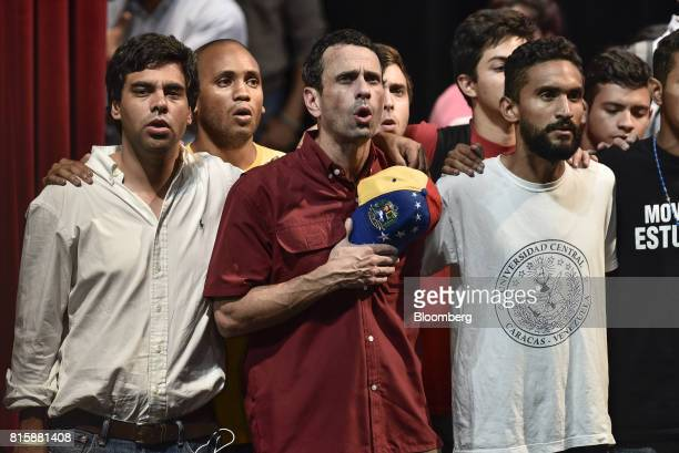 Henrique Capriles governor of Miranda center sings with lawmakers and opposition leaders after the result announcement of a symbolic Venezuelan...