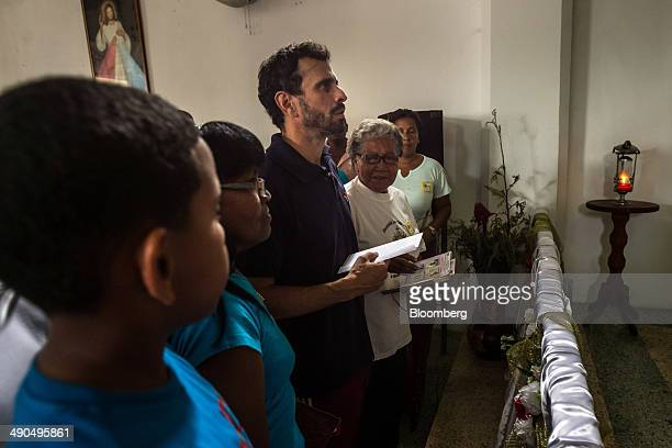 Henrique Capriles governor of the state of Miranda and a former presidential candidate in the last two elections center visits a Catholic church in...