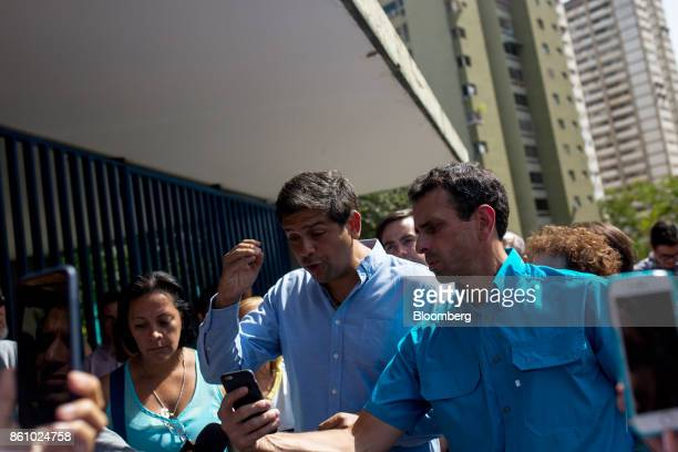 Henrique Capriles opposition leader and former governor of the State of Miranda right uses a smartphone to live stream with periscope Carlos Ocariz...