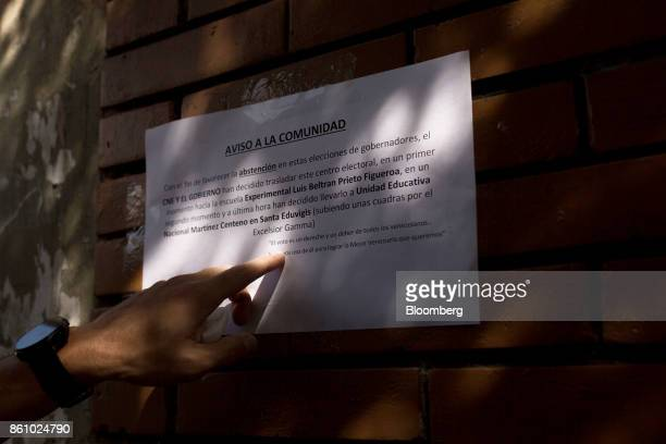 Henrique Capriles opposition leader and former governor of the State of Miranda points to a poster displayed on a wall denouncing the change to a...