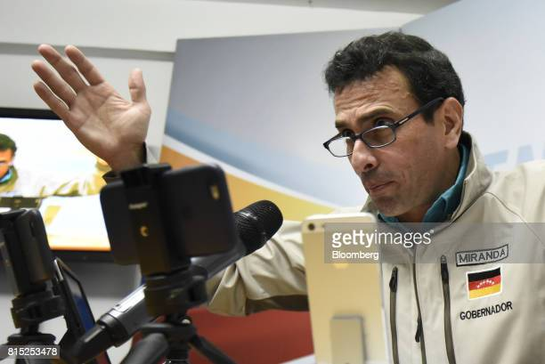 Henrique Capriles opposition leader and governor of the State of Miranda gestures as he speaks during a press conference in Caracas Venezuela on...