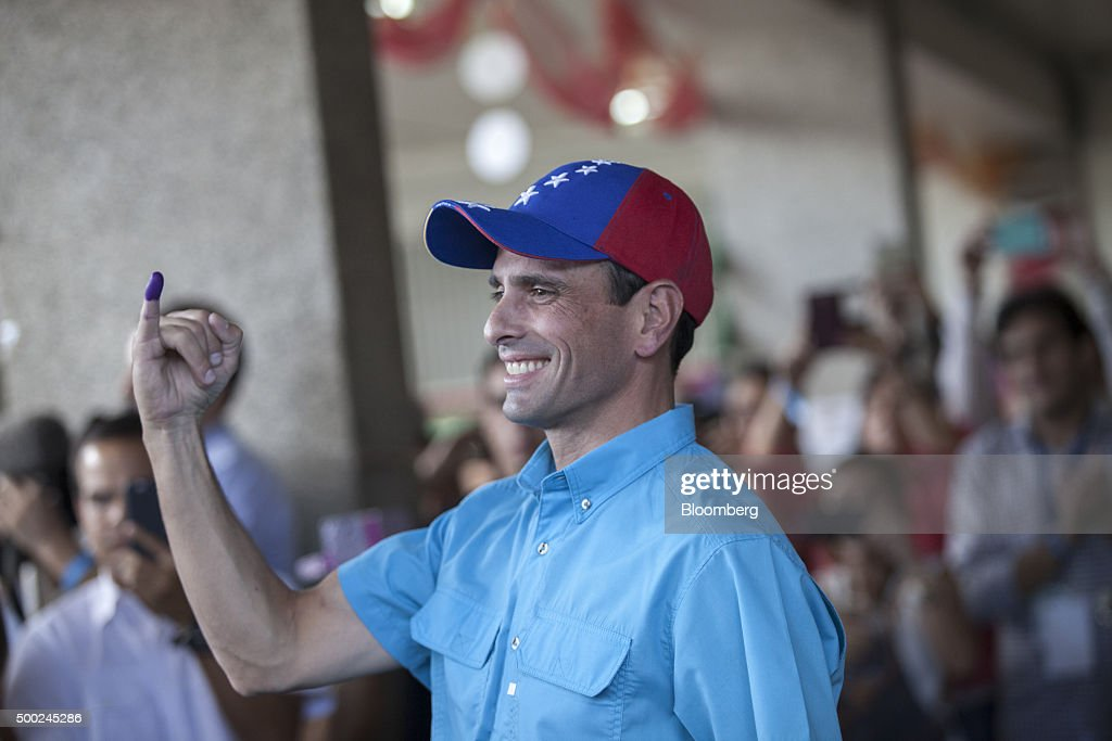 Henrique Capriles, opposition leader and governor of the state of Miranda, displays his inked finger after voting in the national congressional elections in Caracas, Venezuela on Sunday, Dec. 6, 2015. Venezuelans headed to the polls for congressional elections Sunday under an unprecedented economic contraction that is likely to leave the opposition in control of the National Assembly for the first time in 16 years. Photographer: Wilfredo Riera/Bloomberg via Getty Images