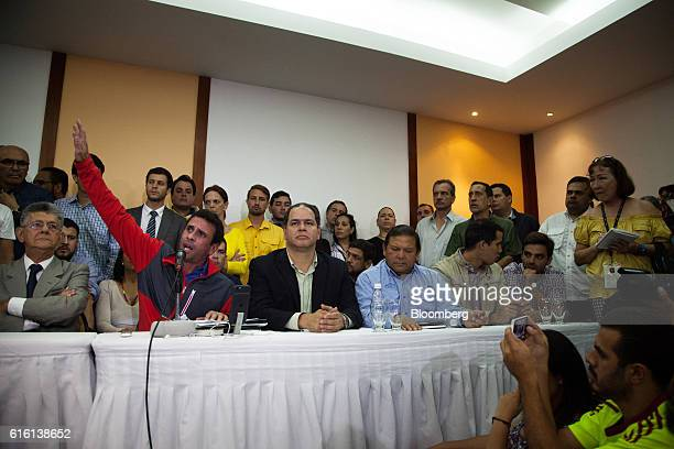 Henrique Capriles opposition leader and governor of the State of Miranda second left gestures as he speaks during a news conference in Caracas...