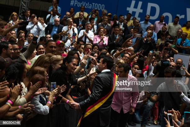 Henrique Capriles opposition leader and governor of the State of Miranda center greets attendees during an event marking his last day as governor in...