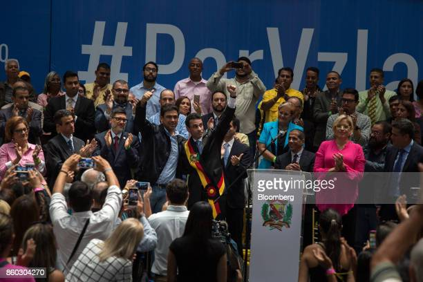 Henrique Capriles opposition leader and governor of the State of Miranda center left gestures during an event marking his last day as governor in...