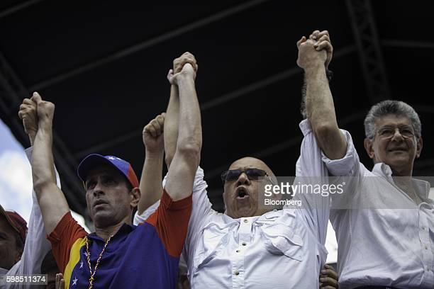 Henrique Capriles opposition leader and twotime presidential candidate left Jesus Torrealba secretarygeneral of the opposition coalition center and...