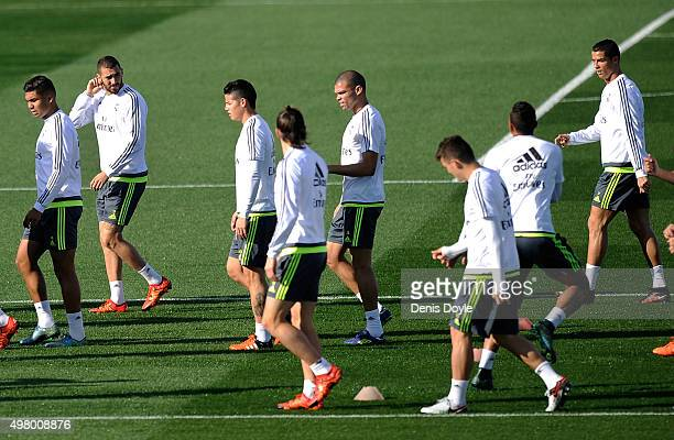 Henrique Casemiro Karim Benzema James Rodriguez Pepe and Cristiano Ronaldo of Real Madrid warmup during the team training session ahead of the La...