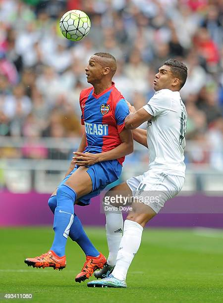 Henrique Casemiro of Real Madrid battles for the ball against Deyverson of Levante during the La Liga match between Real Madrid and Levante at the...