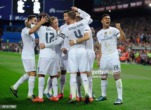 Henrique Casemiro of Real Madrid celebrates after Karim Benzema scored Real's opening goal during the La Liga match between Club Atletico de Madrid...