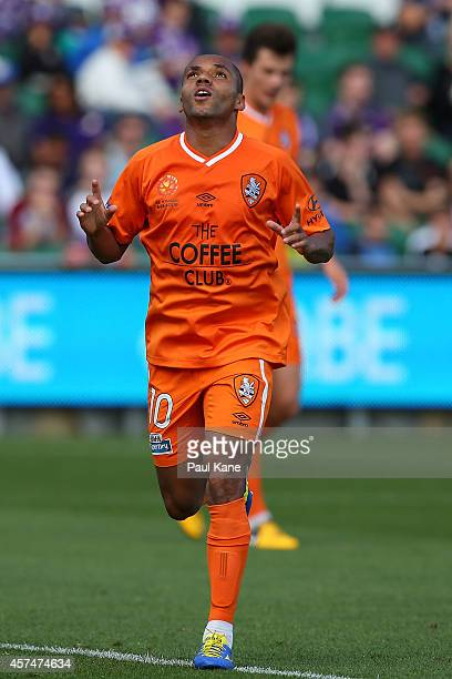 Henrique De Silva of the Roar celebrates after scoring a goal during the round two ALeague match between the Perth Glory and Brisbane Roar at nib...