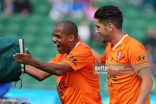 Henrique De Silva of the Roar celebrates after scoring a goal with Dimitri Petratos during the round two ALeague match between the Perth Glory and...
