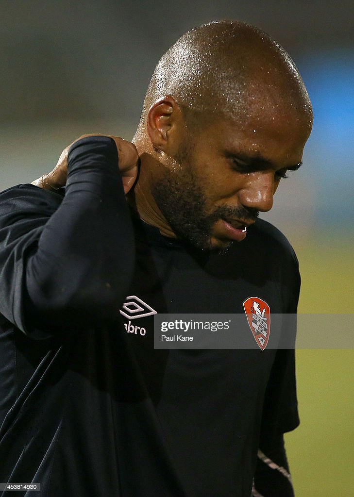 Henrique De Silva of the Roar holds his neck while returning back to the field during the FFA Cup match between the Stirling Lions and the Brisbane Roar at Western Australia Athletics Stadium on August 19, 2014 in Perth, Australia.