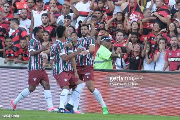 Henrique Dourado of Brazil's Fluminense celebrates with teammates after scoring his first goal against Flamengo during their Copa Carioca final...