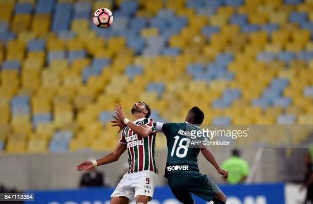 Henrique Dourado of Brazil's Fluminense fights for the ball with Alex Bolanos of Ecuador's Liga de Quito during their 2017 Sudamericana Cup football...