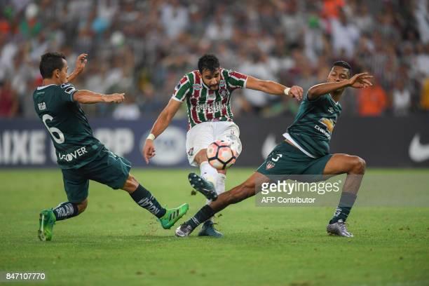 Henrique Dourado of Brazil's Fluminense vies for the ball with Edison Vega of Ecuador's Liga de Quito during their 2017 Sudamericana Cup football...