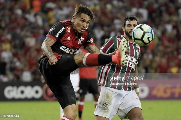 Henrique Dourado of Fluminense battles for the ball with Guerrero of Flamengo during the match between Fluminense and Flamengo as part of Brasileirao...