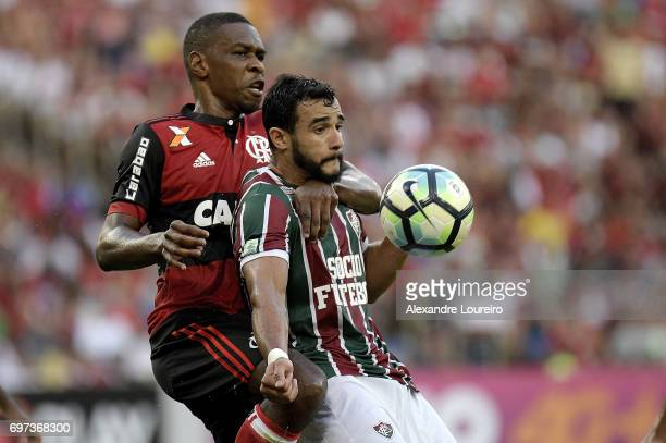 Henrique Dourado of Fluminense battles for the ball with Juan of Flamengo during the match between Fluminense and Flamengo as part of Brasileirao...