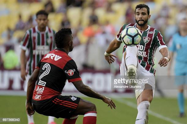 Henrique Dourado of Fluminense battles for the ball with Rodinei of Flamengo during the match between Fluminense and Flamengo as part of Brasileirao...