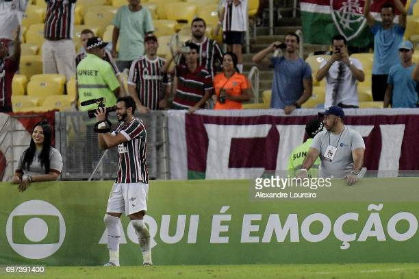 Henrique Dourado of Fluminense celebrates a scored goal pretending to be filming the other players during the match between Fluminense and Flamengo...