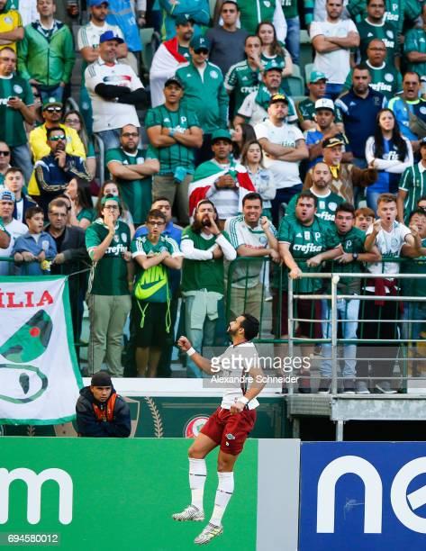 Henrique Dourado of Fluminense celebrates their first during the match between Palmeiras and Fluminense for the Brasileirao Series A 2017 at Allianz...