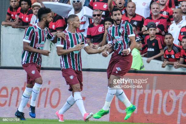 Henrique Dourado of Fluminense celebrates with teammates after scoring his first goal against Flamengo during their Copa Carioca final football match...