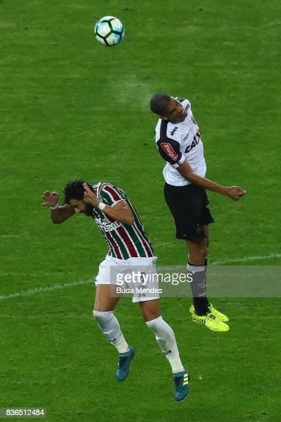Henrique Dourado of Fluminense struggles for the ball with Leonardo Silva of Atletico MG during a match between Fluminense and Atletico MG part of...