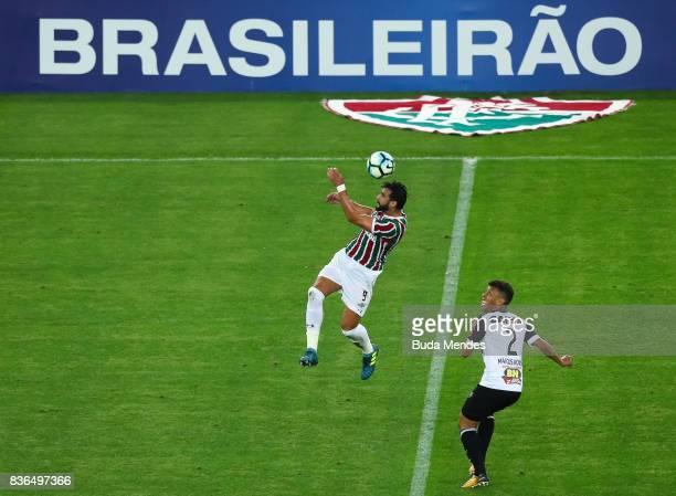 Henrique Dourado of Fluminense struggles for the ball with Marcos Rocha of Atletico MG during a match between Fluminense and Atletico MG part of...