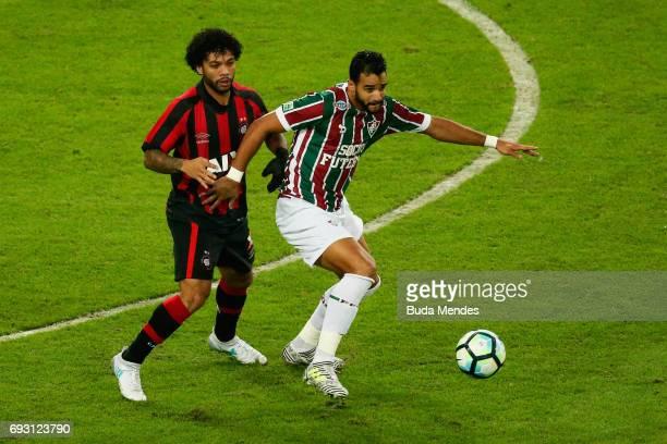 Henrique Dourado of Fluminense struggles for the ball with Otavio of Atletico PR during a match between Fluminense and Atletico PR as part of...