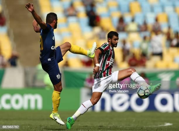 Henrique Dourado of Fluminense struggles for the ball with Thiago Maia of Santos during a match between Fluminense and Santos as part of Brasileirao...