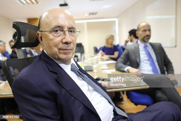 Henrique Meirelles Brazil's minister of finance left sits during a meeting with Dara Khosrowshahi chief executive officer of Uber Technologies Inc in...