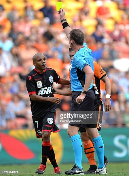 Henrique of Adelaide is given a yellow card after fouling Dimitri Petratos of the Roar during the round 10 ALeague match between the Brisbane Roar...