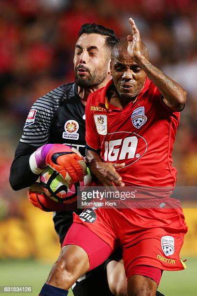 Henrique of Adelaide United competes for the ball as Dean Bouzanis of Melbourne City makes a save during the round 15 ALeague match between Adelaide...