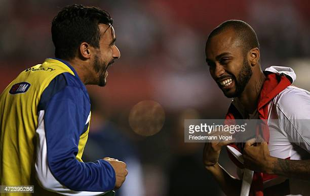 Henrique of Cruzeiro talks with Wesley of Sao Paulo during a first leg match between between Sao Paulo and Cruzeiro as part of round of sixteen of...