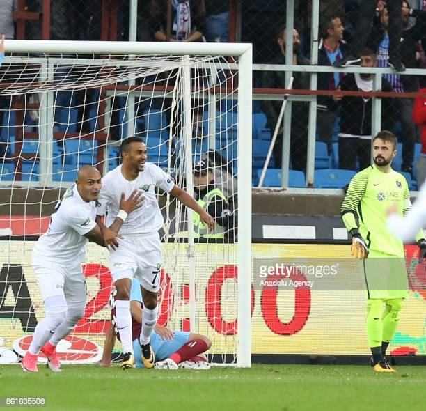 Henrique of Teleset Mobilya Akhisarspor celebrates with his teammate Serginho after scoring during the Turkish Super Lig match between Trabzonspor...