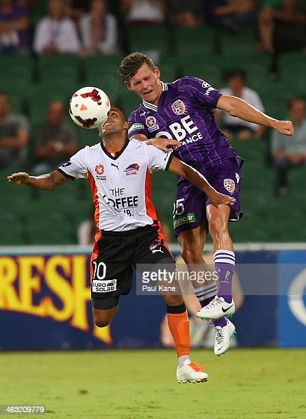 Henrique of the Roar and Riley Woodcock of the Glory contest for the ball during the round 15 ALeague match between Perth Glory and the Brisbane Roar...