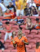 Henrique of the Roar celebrates after scoring a goal during the round 17 ALeague match between Brisbane Roar and the Central Coast Mariners at...