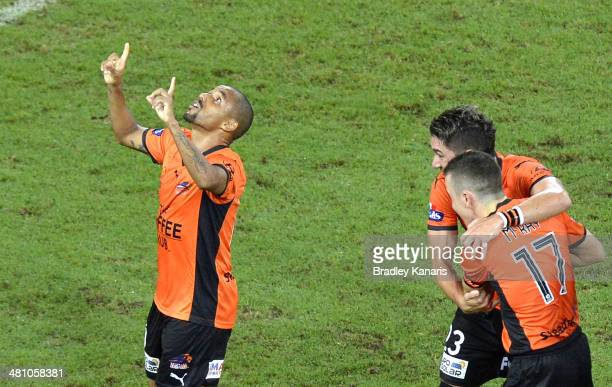Henrique of the Roar celebrates after scoring a goal during the round 25 ALeague match between Brisbane Roar and Melbourne Heart at Suncorp Stadium...