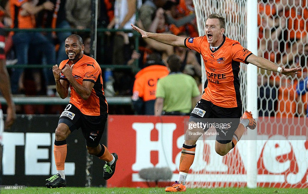 Henrique (L) of the Roar celebrates after scoring a goal in extra time as team mate <a gi-track='captionPersonalityLinkClicked' href=/galleries/search?phrase=Besart+Berisha&family=editorial&specificpeople=737057 ng-click='$event.stopPropagation()'>Besart Berisha</a> can be seen celebrating during the 2014 A-League Grand Final match between the Brisbane Roar and the Western Sydney Wanderers at Suncorp Stadium on May 4, 2014 in Brisbane, Australia.