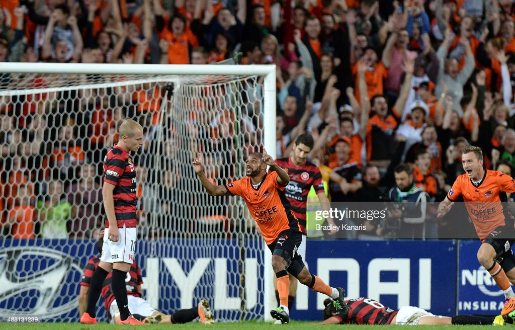 Henrique of the Roar celebrates after scoring a goal in extra time during the 2014 A-League Grand Final match between the Brisbane Roar and the Western Sydney Wanderers at Suncorp Stadium on May 4, 2014 in Brisbane, Australia.