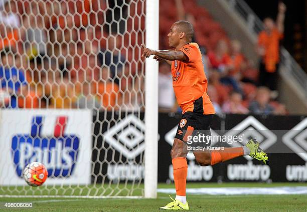 Henrique of the Roar celebrates scoring a goal during the round seven ALeague match between the Brisbane Roar and Melbourne City FC at Suncorp...