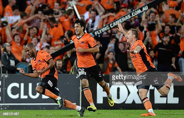 Henrique of the Roar celebrates scoring a goal in extra time as team mates Thomas Broich and Besart Berisha are seen celebrating during the 2014...