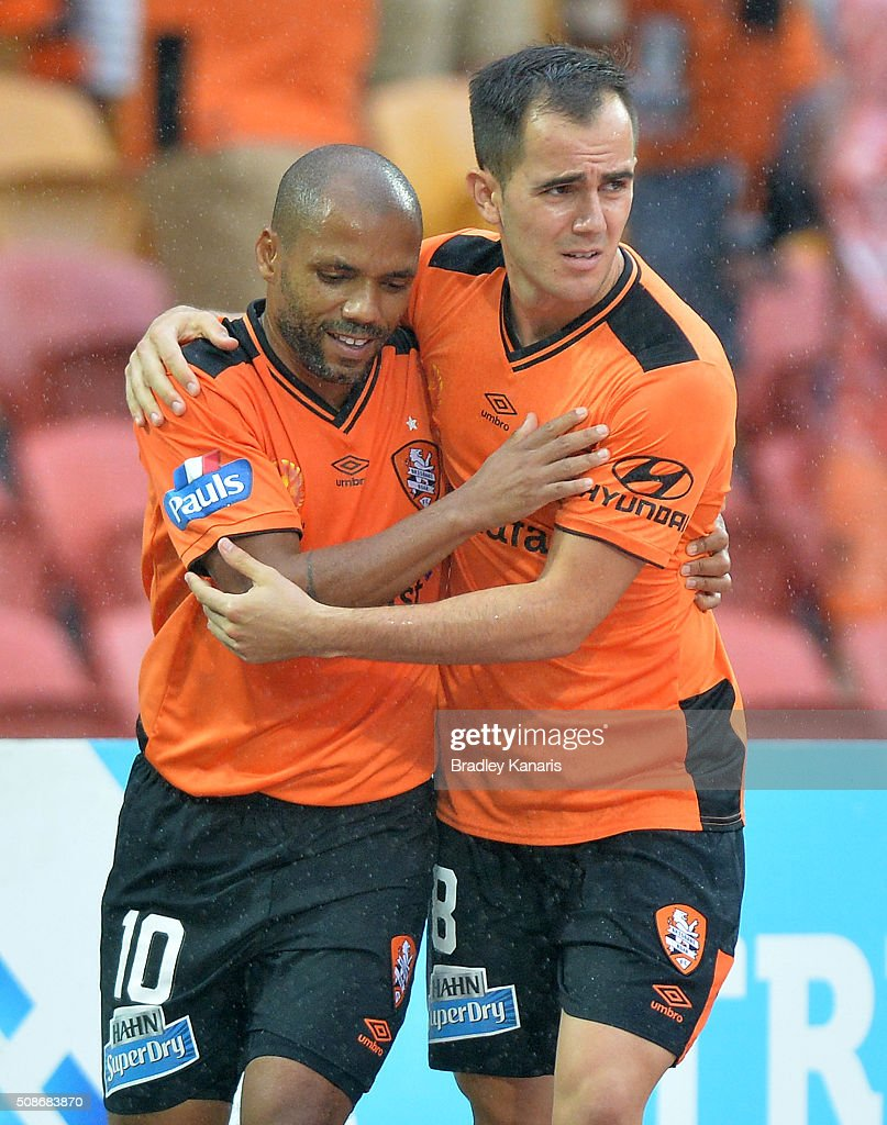 Henrique of the Roar celebrates scoring a goal with team mates Steven Lustica of the Roar during the round 18 A-League match between the Brisbane Roar and Central Coast Mariners at Suncorp Stadium on February 6, 2016 in Brisbane, Australia.
