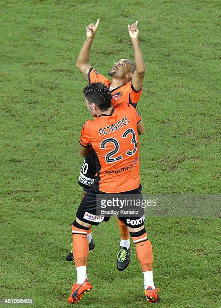 Henrique of the Roar celebrates with team mate Dimitri Petratos after scoring a goal during the round 25 ALeague match between Brisbane Roar and...