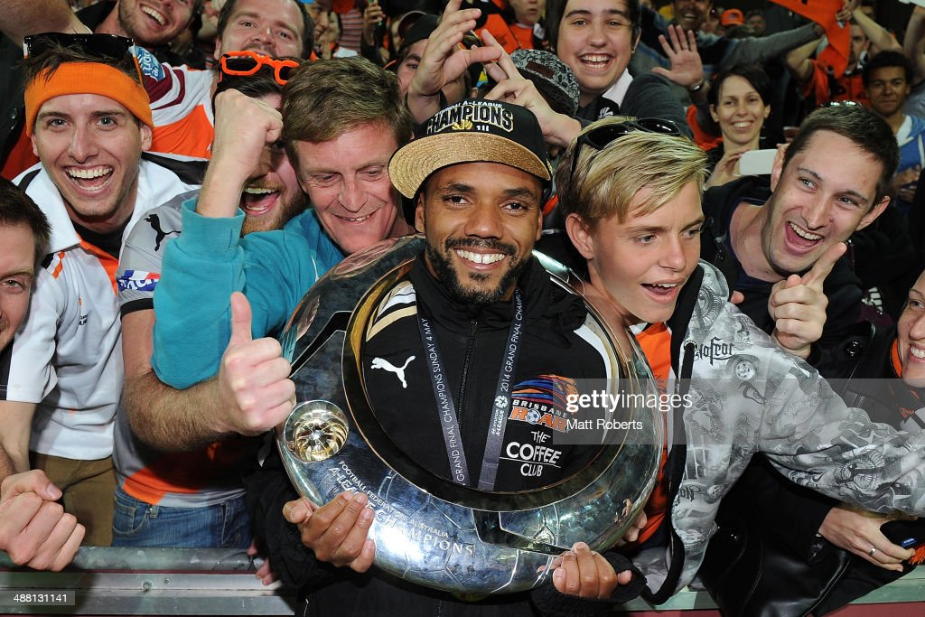 Henrique of the Roar poses for a photograph with fans after winning the 2014 A-League Grand Final match between the Brisbane Roar and the Western Sydney Wanderers at Suncorp Stadium on May 4, 2014 in Brisbane, Australia.