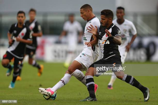 Henrique of Vasco struggles for the ball with Richarlison of Fluminense during a match between Vasco and Fluminense part of Brasileirao Series A 2017...