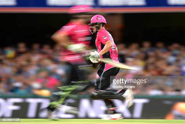 Henriques Moises and Daniel Hughes of the Sixers run between wickets during the Big Bash League semi final match between the Brisbane Heat and the...